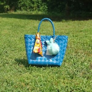 Blue handwoven bag with charm and twilly
